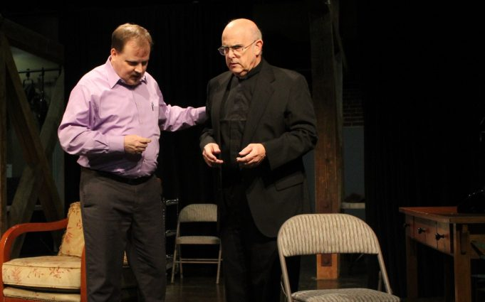 "Daniel Corban (J. Christopher Penick) and Father Kelleher (Mark Shullenbarger) in ""Catch Me If You Can"" at the Arts Barn."