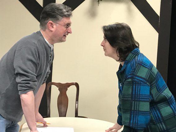 Baron Franz von Freytag (John Morogiello) squares off against Frau Schmidt (Rebecca A. Herron) while rehearsing.