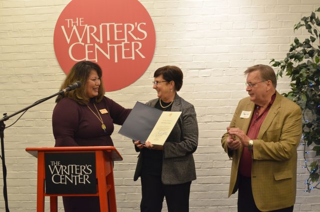 Lillian Cruz, Senior Advisor from Chris Van Hollen's office, Writer's Center Executive Director Margaret Meleney and Writer's Center Chairman John Hill shared the stage at a Writer's Center Opening Event.