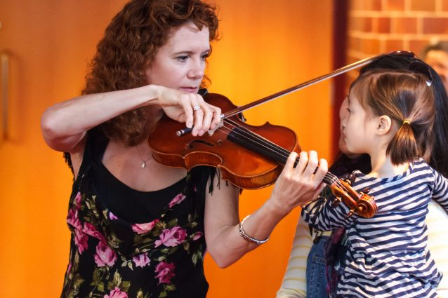 BSO violinist Ellen Pendleton Troyer captures the attention of the young children at a Music Box concert.