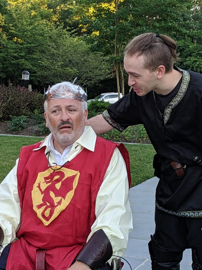 King Arthur (Peter Wolff) and Mordred (Erin Kelman) share a peaceful moment in Camelot.