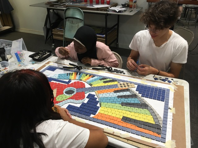 """Arts on the Block apprentices work on Emmanuel's """"Refreshing Music."""""""
