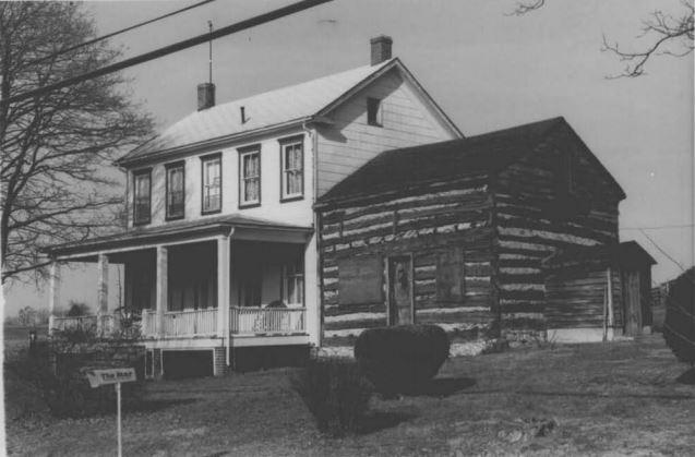 The Grusendorf Log Cabin in its original Germantown location, December 1974.