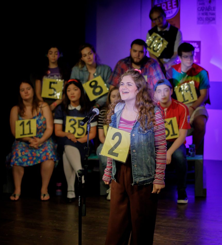 "Marney Harris competes as contestant #3 in Wildwood Summer Theatre's production of ""The 25th Annual Putnam County Spelling Bee."""