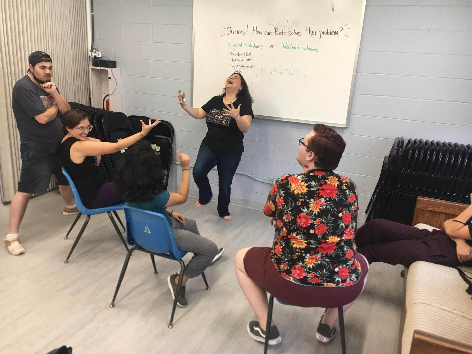 Artistic Director Ali Oliver-Krueger leads company members in a workshop process developing the forum theatre elements of the play.