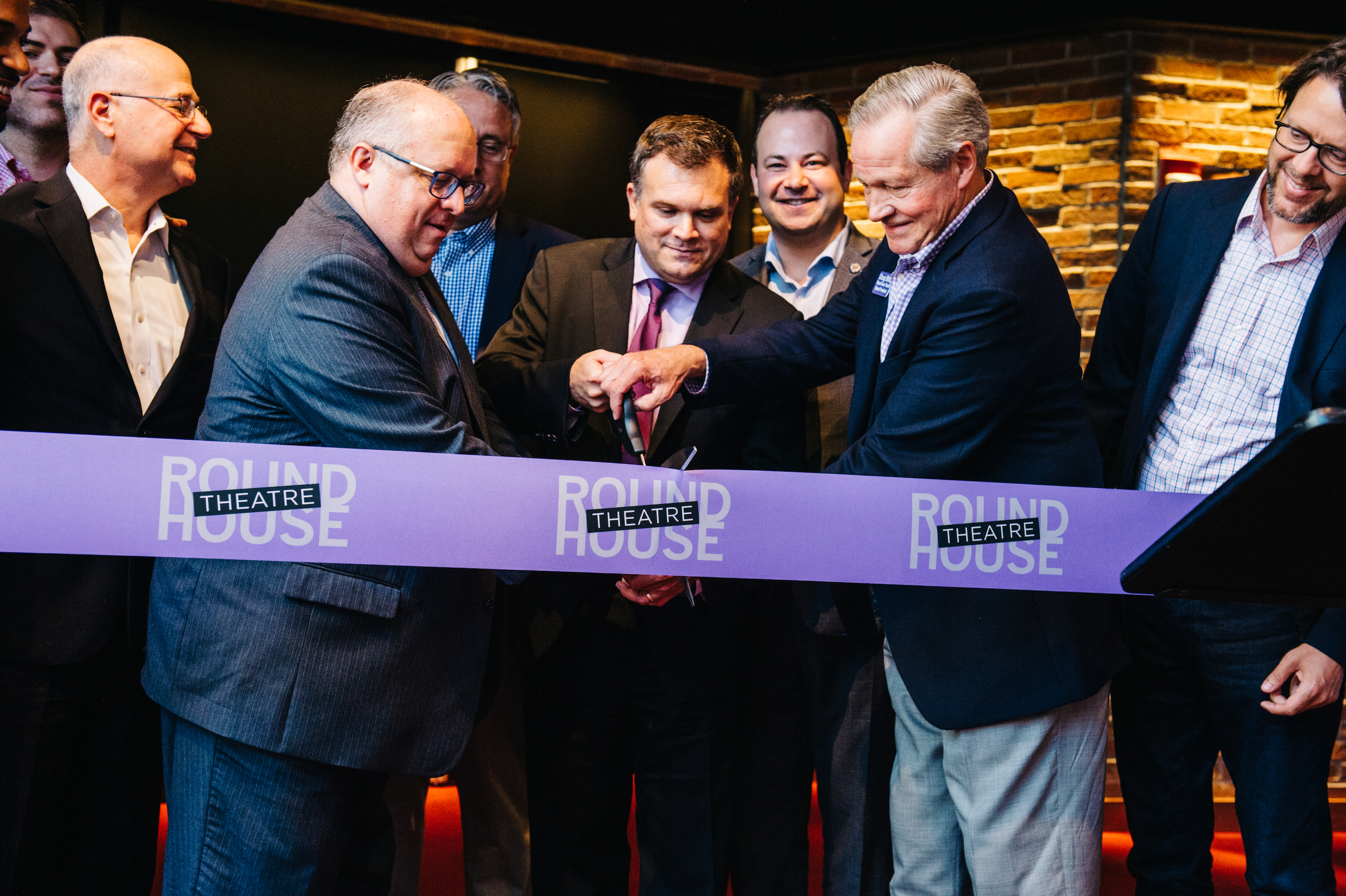 Cutting the ribbon on the newly renovated theatre at a recent Open House for the community: Managing Director Ed Zakreski, Artistic Director Ryan Rilette and Board President Doug Bibby.