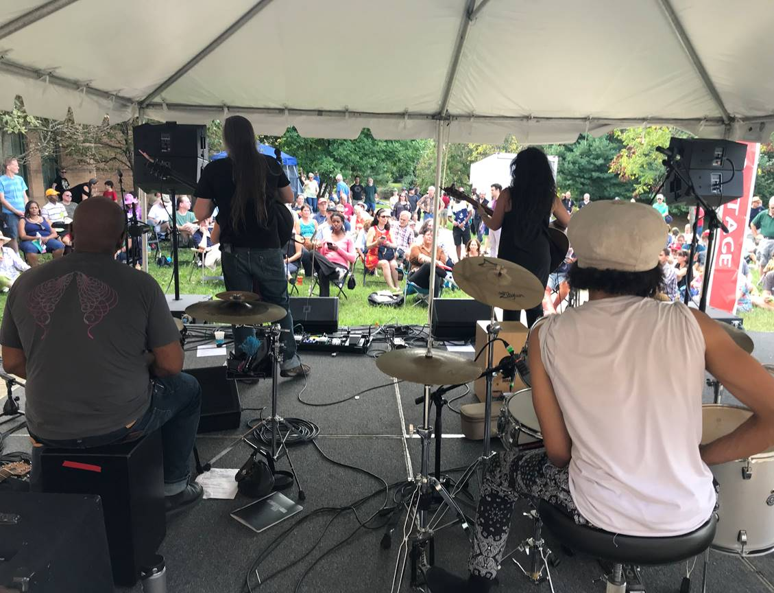 A musician's eye view of the crowd on the Field Stage with ilyAIMY performing percussive, harmonious rock folk by award-winning songwriters (2018).