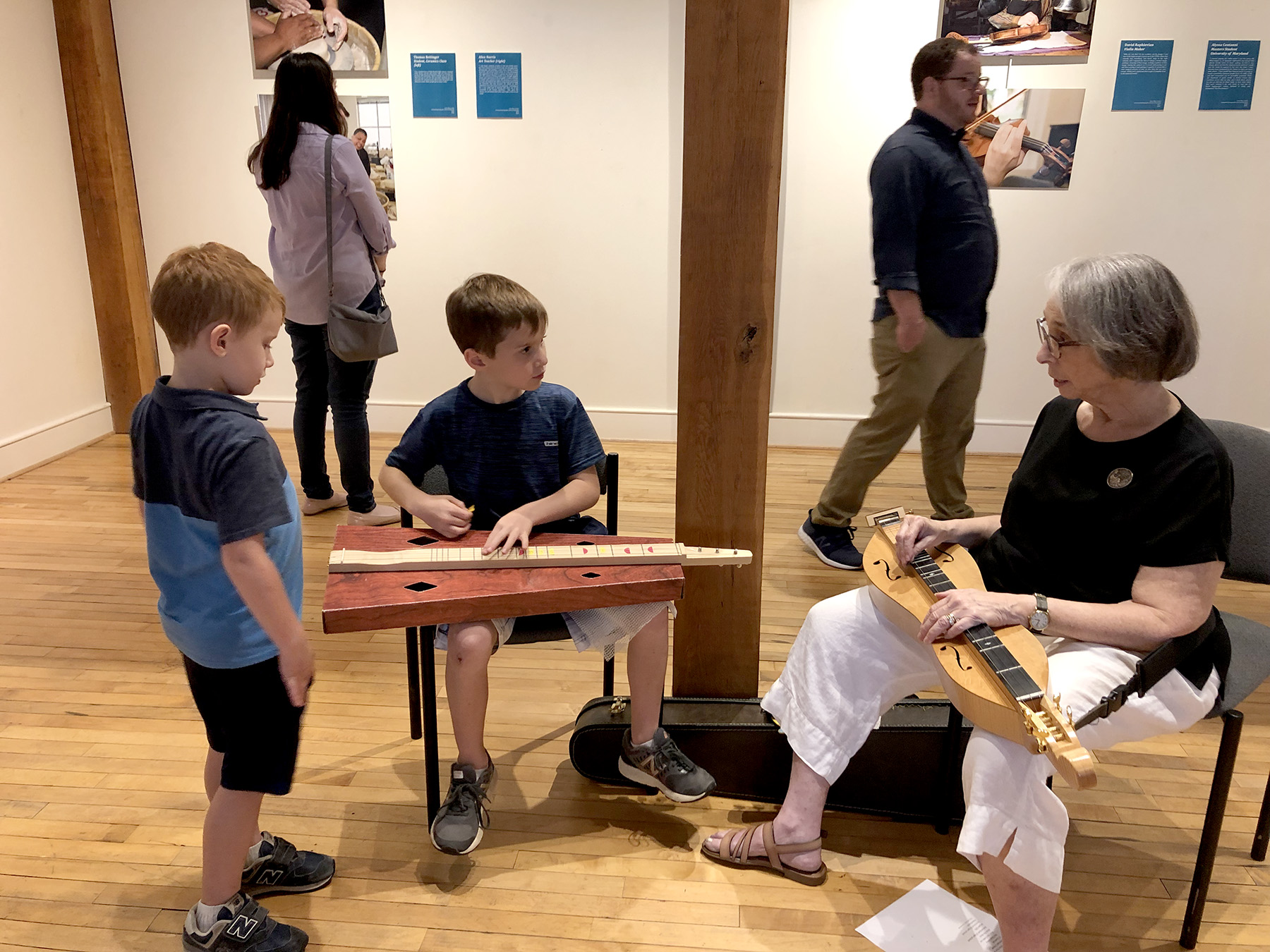 Young visitors to the Sandy Spring Museum meet dulcimer artist and teacher Karen Buglass.