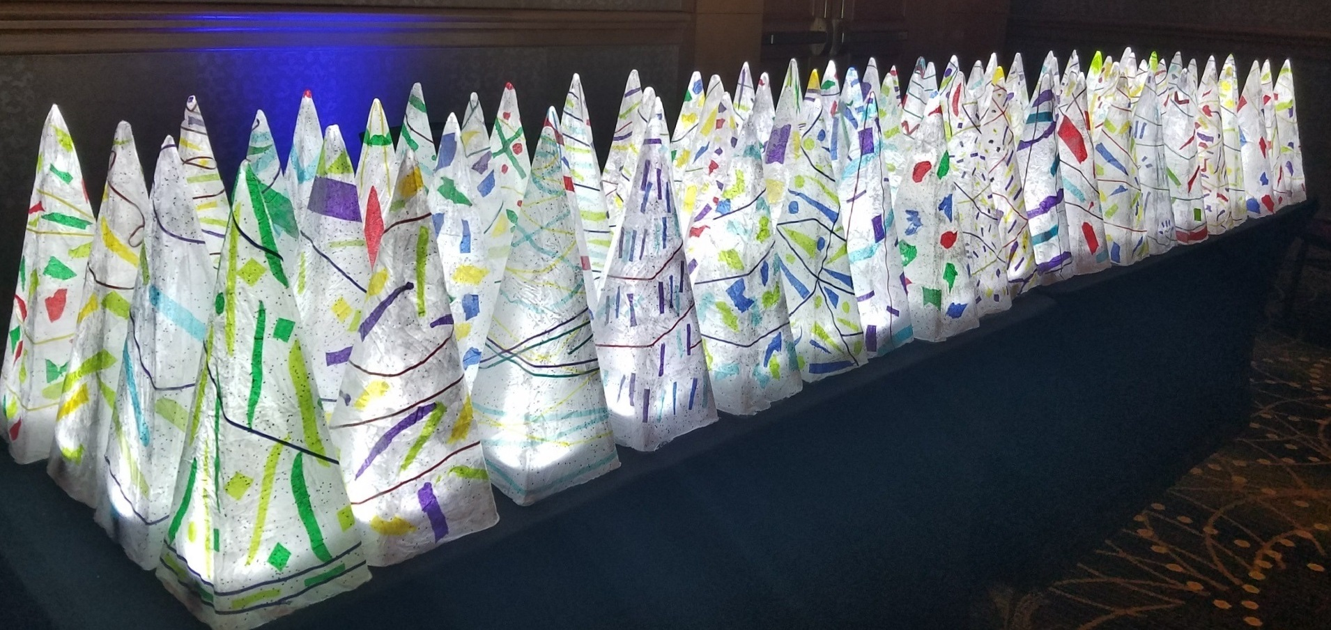 Women incarcerated at the Montgomery County Correctional Facility created more than 100 papier-mâché and ribbon centerpieces in the jail's workroom for the Montgomery County Executive's Ball for the Arts & Humanities. Caren Quiroga was the lead artist.
