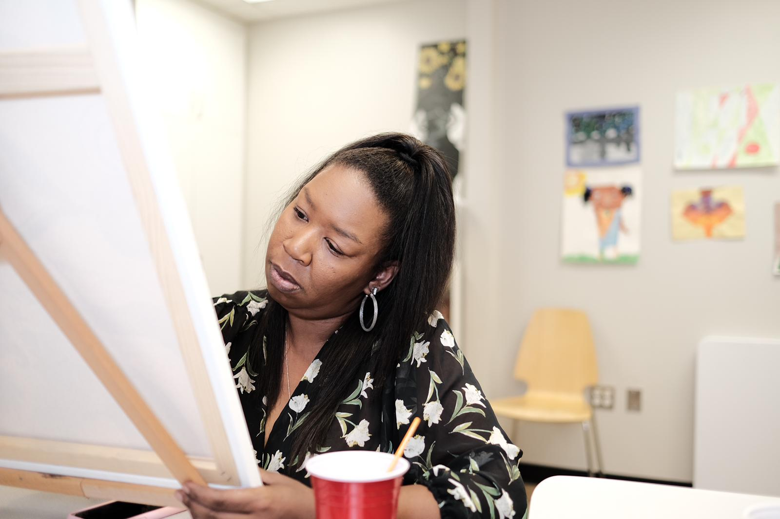 Montgomery County native and artist, teacher, coach and trainer Tychelle Mosely works at the FAsMarketplace.