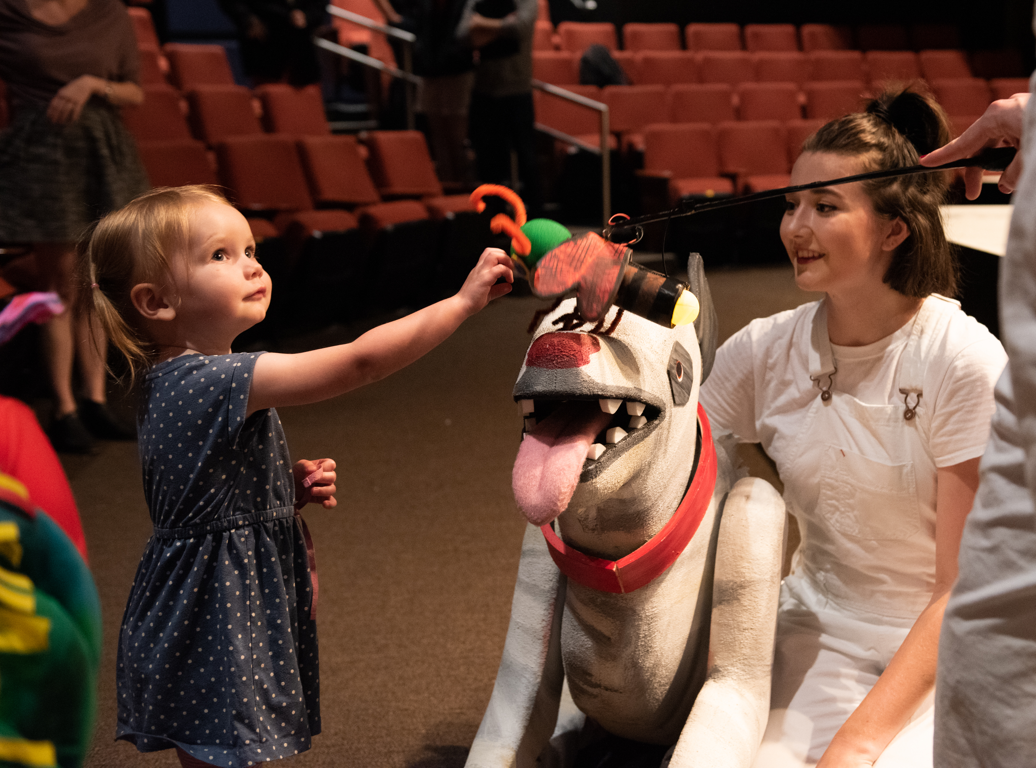 "A very young audience member meets Emily Whitworth at ""The Very Hungry Caterpillar Show"" at Imagination Stage."