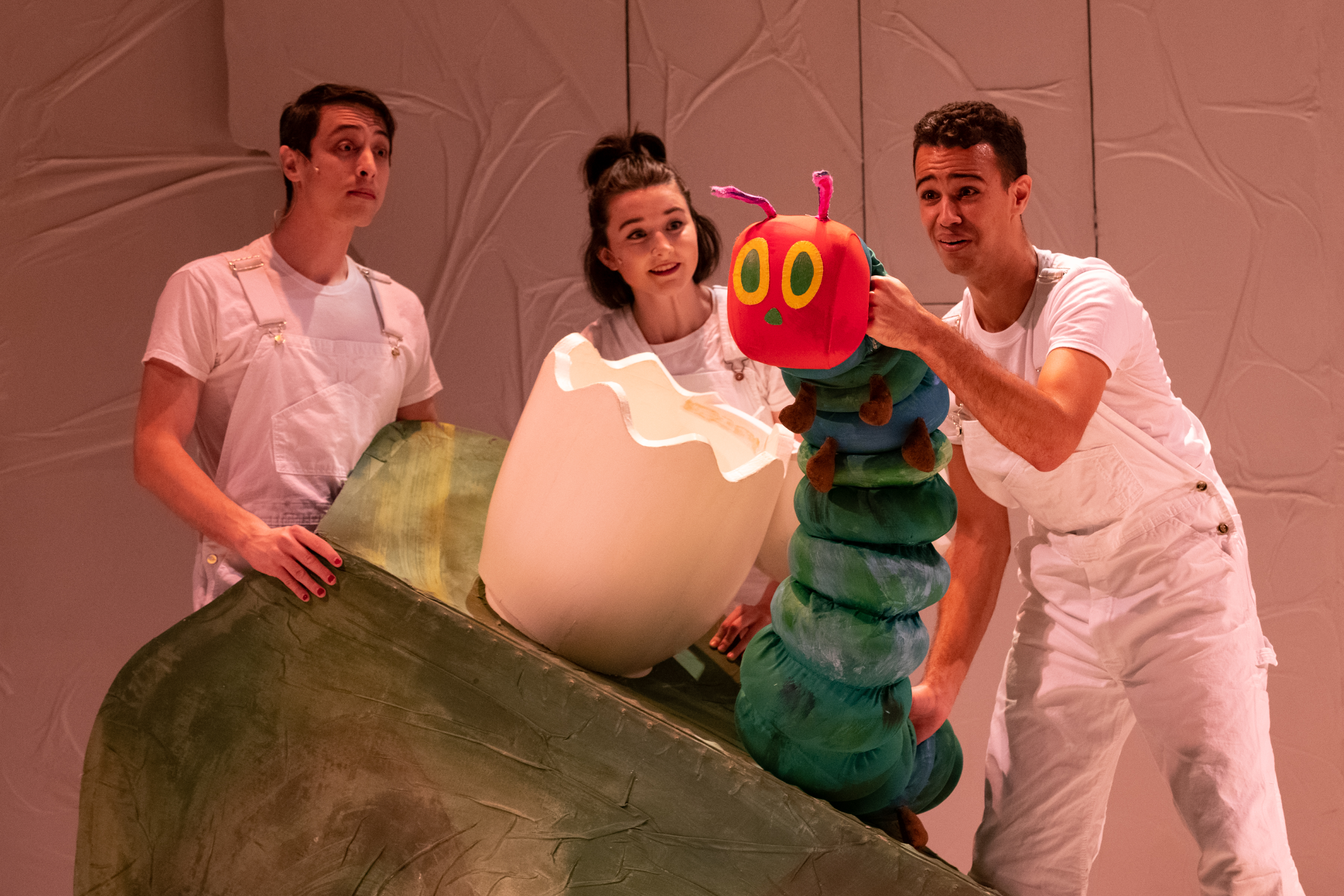 Actor-puppeteers Daniel Glenn Westbrook, Emily Whitworth and Alex Turner with a very hungry friend.