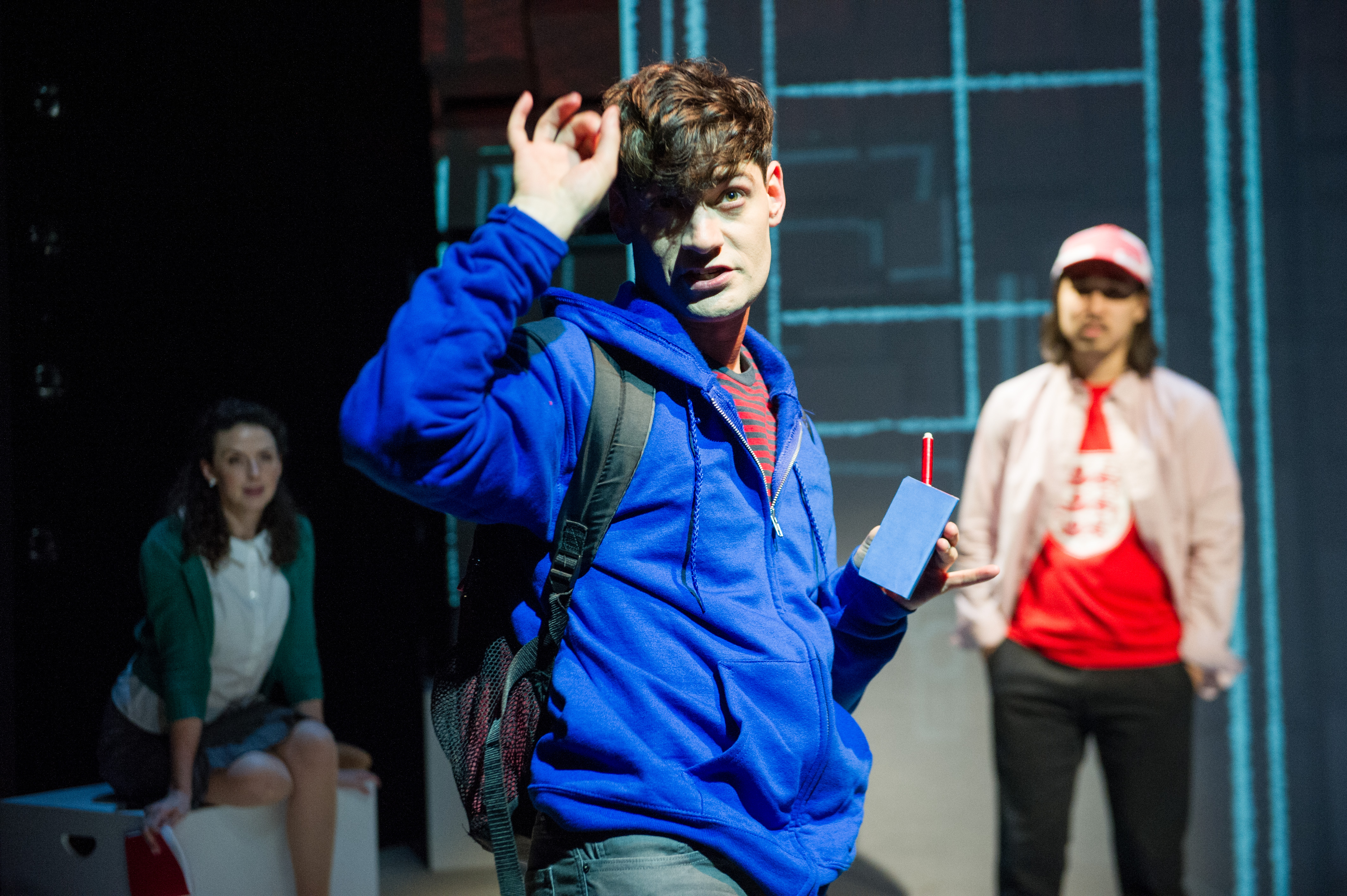 "Harrison Bryan (center) plays Christopher, a teenager on a journey to solve a mysterious ""Curious Incident."" Tessa Klein (left) plays Siobhan and Cody LeRoy Wilson (right) is Voice 3."