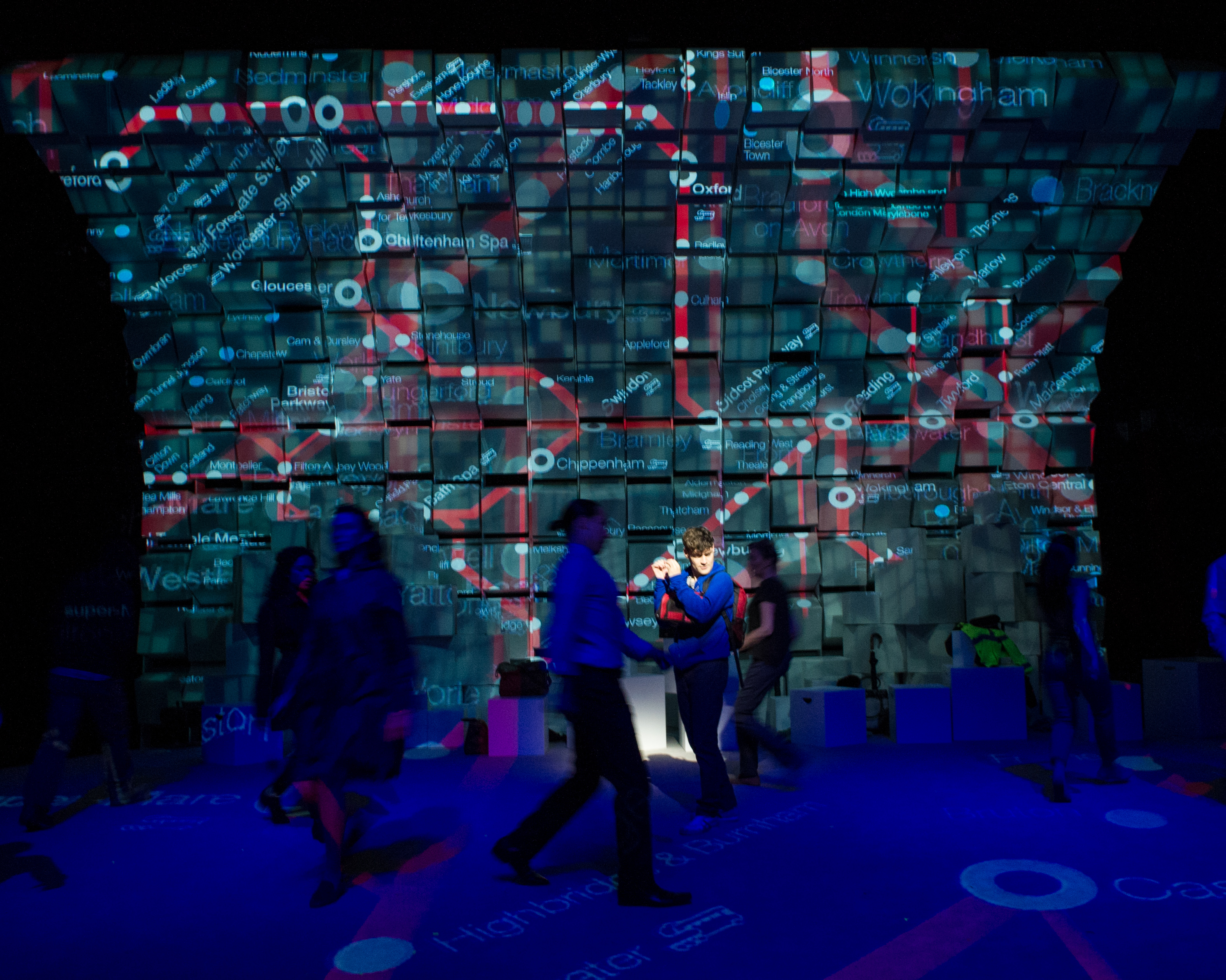 """The cast, with a projected London Underground helping tell the story of """"The Curious Incident of the Dog in the Night-Time."""""""