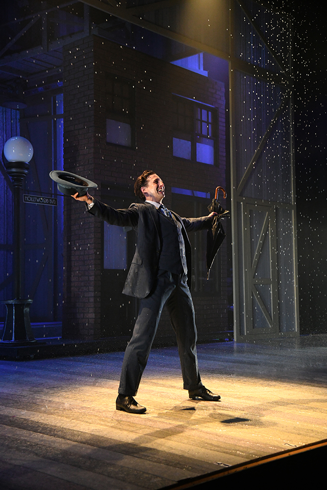 Iconic: Rhett Guter channels Gene Kelly, singing (and dancing) in the rain.
