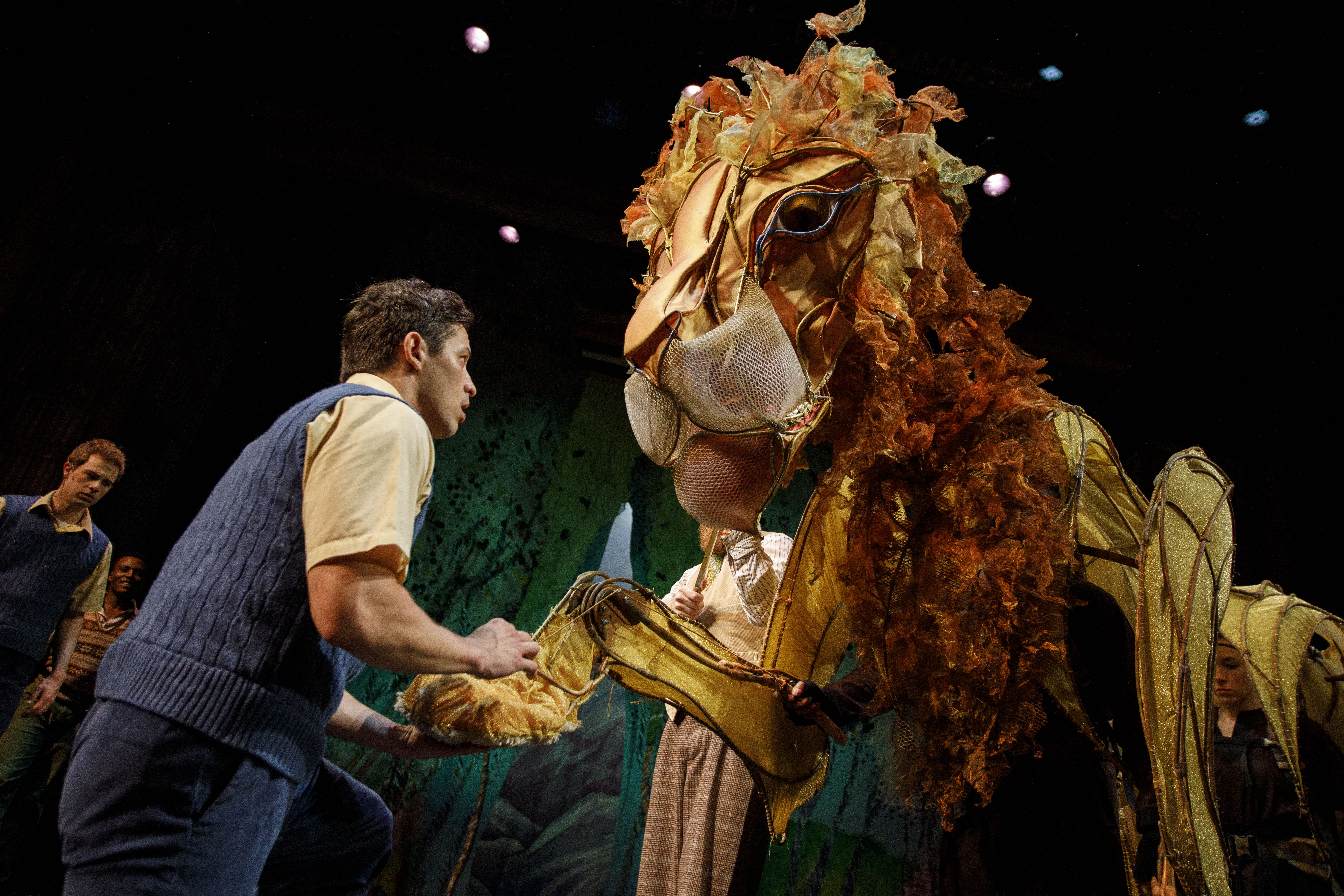 Ryan Sellers as Edmund Pevensie (dancer) with Aslan the Lion.