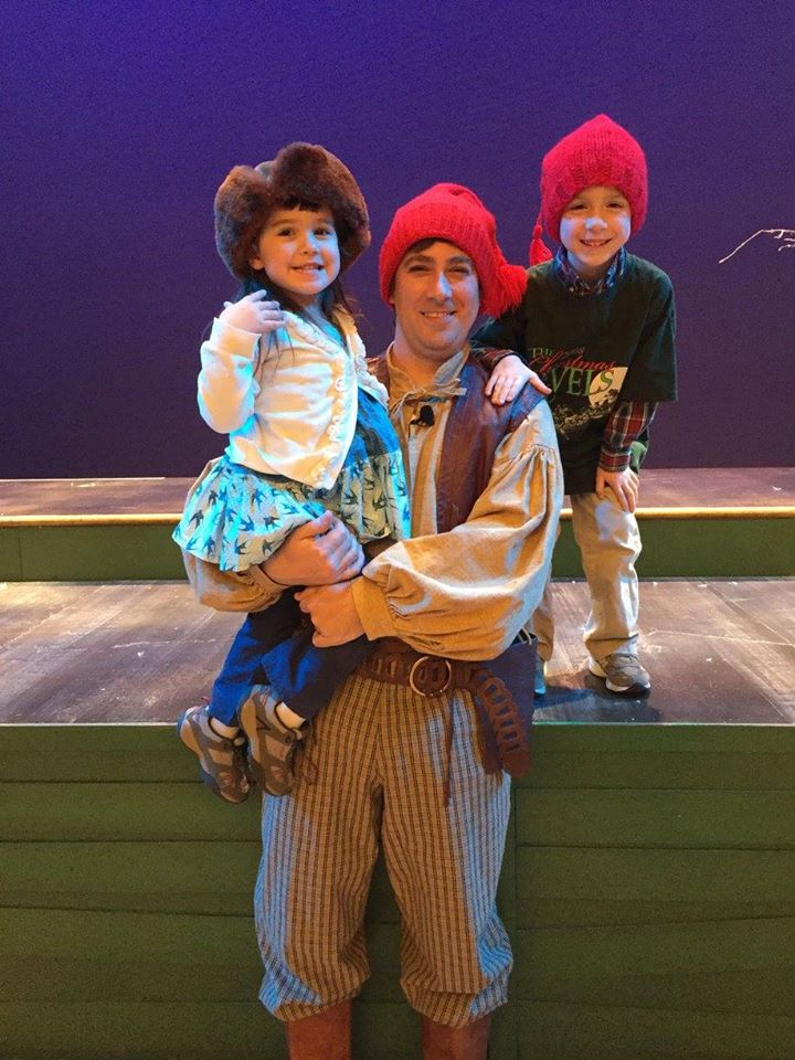 Chris Lewis with his children after a 2017 French-Canadian Christmas Revels performance.